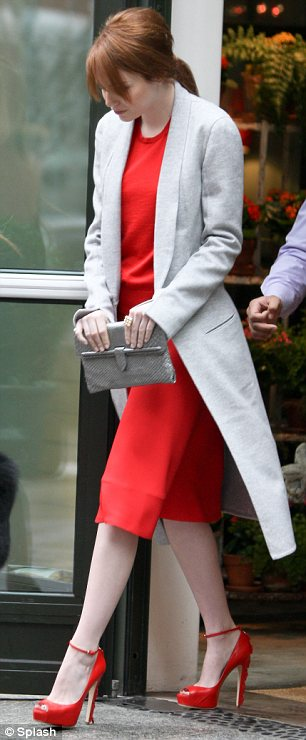 Red-dy or not... she's coming: Emma is promoting the upcoming Spiderman reboot movie