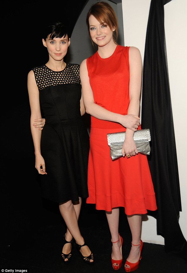 A perfect match: Rooney Mara (L) and Emma Stone each wore outfits that matched their respective hair colours
