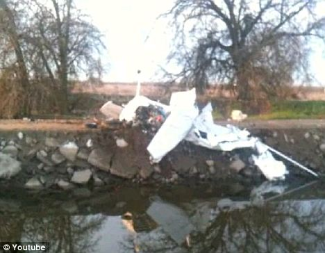 Wrecked: The single engine stolen Cessna plane was found upside down having crashed into a canal near the airport where it was taken from