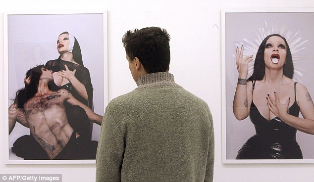 Obscenity: The exhibition by Canadian artist Bruce Labruce features Alaska - a singer well known in Spain - dressed as a sexy saint in black with a communion wafer on her tongue, pictured