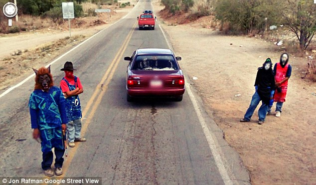 Bizarre: A group of men wear masks and appear to pose for the camera as the car photographs the outskirts of Nacozari De Garcia in Mexico