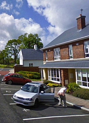 A man bares his bottom as the car goes past an address in Ireland