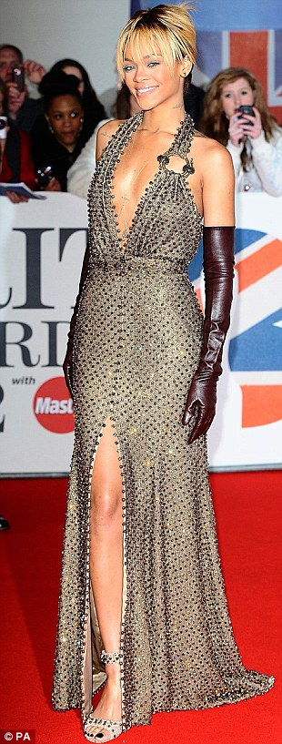 Showing off her curves: Rihanna showed off some serious skin in this plunging gold sequin number, trumping British stars like Jessie J