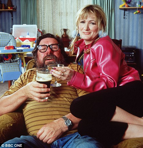 Traditional man: The old-school Jim Royle habit of reading the newspaper on the toilet is giving way to bog-time smartphones. Royle Family star Jim is played by Ricky Tomlinson, pictured here with onscreen daughter Caroline Aherne.