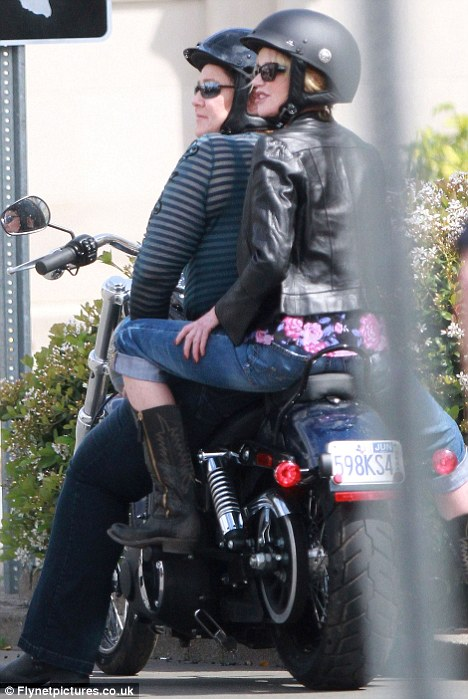 Melanie Griffith Dons A Leather Jacket And Cowboy Boots As