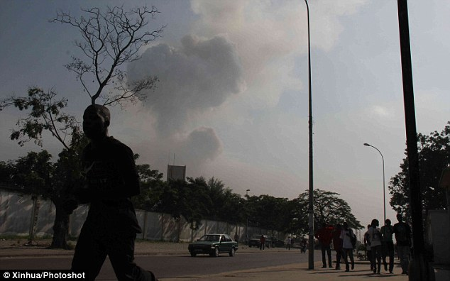 Explosion: People run for safety after a series of blasts at a weapons depot in Brazzaville, the capital of the Republic of Congo