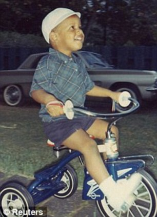 As a child: Barack Obama seen riding a tricycle in his youth and right, with his mother Ann Dunham, who moved him to Jakarta after her divorce