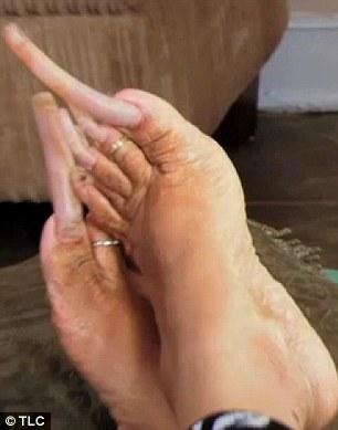 Ayanna's longest toenail is four inches long she estimates