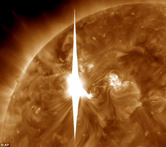 Heading our way! A Nasa handout photo shows the massive solar flare that could affect power grids, GPS and airplane flights