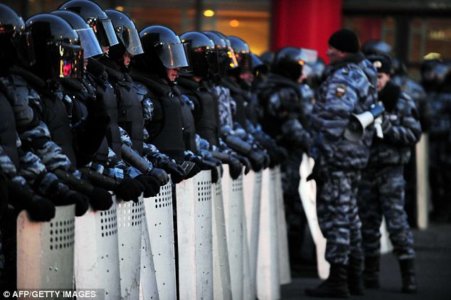 Ring of steel: Riot police officers cordon off the area of an opposition rally to demand fair elections at the Pushkinskaya Square in central Moscow, where some 5,500 people gathered to protest