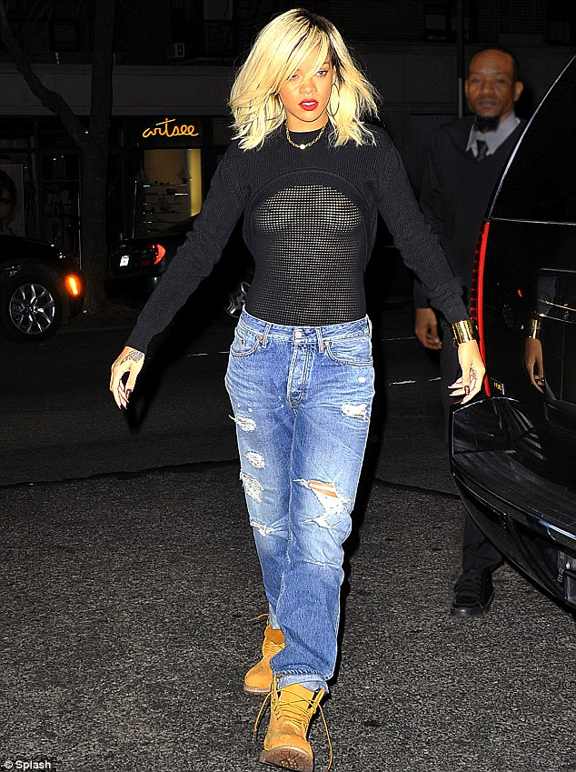 Daring to bare: Rihanna made sure people could see her assets by wearing a see-through top in New York tonight