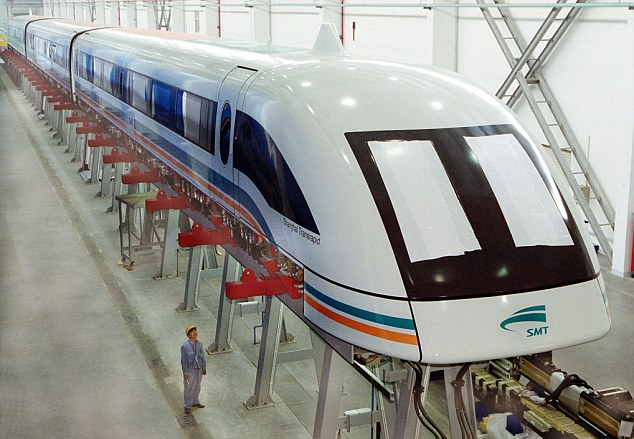 A worker looks at the world's first passenger train that uses magnets to propel it at speeds up to 270 mph, in Shanghai. One of the designers of 'maglev' trains is behind the proposed 'StarTram' system