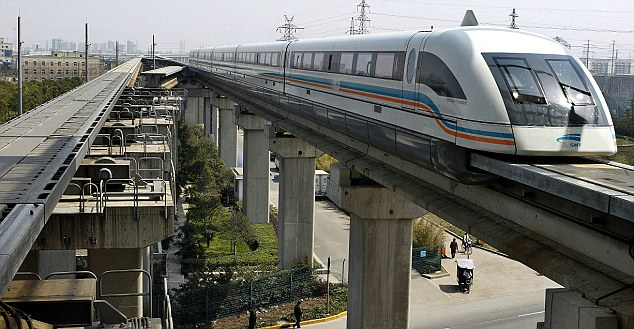 A Maglev train driving into terminal station in Shanghai, China: The underlying technology of StarTram would be similar, but on a 'railway' to the sky suspended by magnetic forces