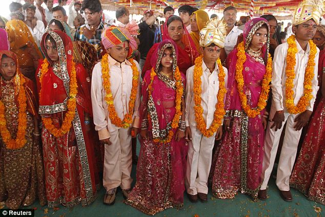 Wed alert: Boys and girls from the Saraniya community wearing garlands pose for pictures after their engagement ceremony