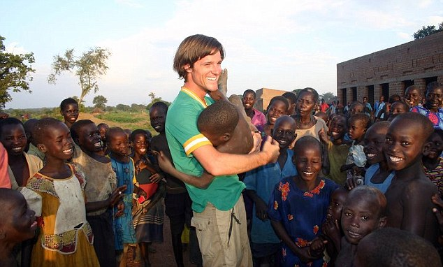 Campaigner: Mr Russell on a trip to Africa, where he was first inspired to set up the charity Invisible Children