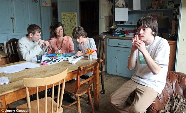 Proud of her family: Charlotte Moore at home with her autistic sons, George (left) and Sam (right). Her youngest boy, Jake (second right) does not have the condition