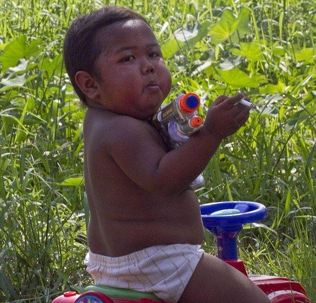 Shock: It's not the first time a shocking photo of a child smoking in Indonesia has emerged - a photo was released showing Ardi Rizal's a two-year-old, whose health has been so ruined by his 40-a-day habit that he now struggled to move by himself