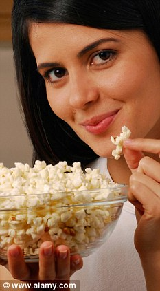 As well as being a great diet food, popcorn also contains a high level of antioxidents, which help fight harmful molecules. Posed by model