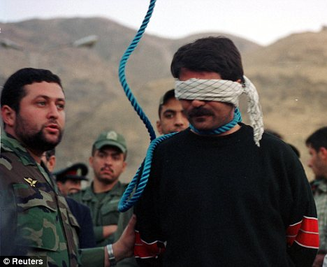 To death: A convicted murderer in Iran awaits his execution. Iran's most usual form of execution is hanging