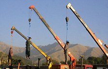 TEHRAN, IRAN: (L-R): Amir Fakhri, Payam Amini, and Majid Ghasemi, sentenced to death, are seen dangling from cranes in east Tehran 29 September 2002