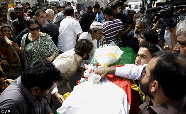 Mourning: Fakhra Younus's body is carried through Karachi airport in her native Pakistan after her body was returned to the country from Italy