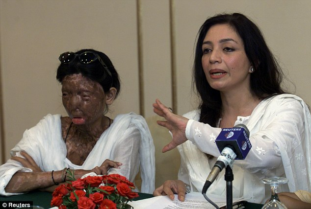 Disfigured: Younus, left, pictured with supporter Tehmina Durrani, has undergone 39 separate surgical operations to repair the damage done to her face