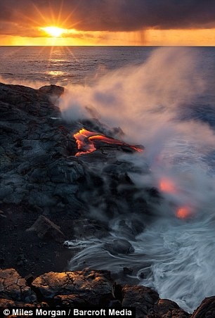 Sun bursting through the background as lava flows from the coast