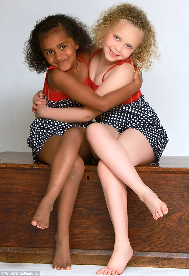 Loving: Black and white twin sisters Kian and Remee, seven years after they came into the world