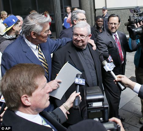 Shamed: Monsignor Lynn, seen outside the Criminal Justice Centre in Philadelphia last month, has been charged with child endangerment