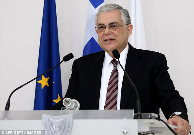 Protests: Greek Prime Minister Lucas Papademos holds a press conference upon his arrival in Cyprus yesterday