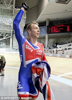 Chris Hoy from Britain reacts after winning the men's keirin