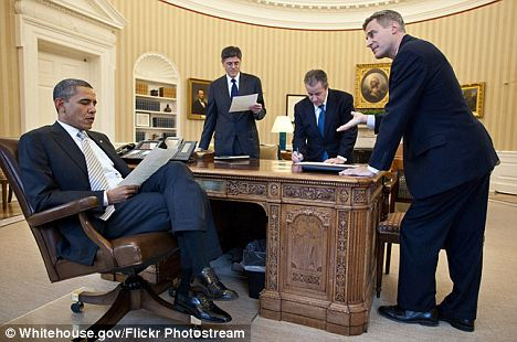 Even fewer: In this 2011 photo, Mr Obama is only conferring with his top three closest advisors, all of whom are male
