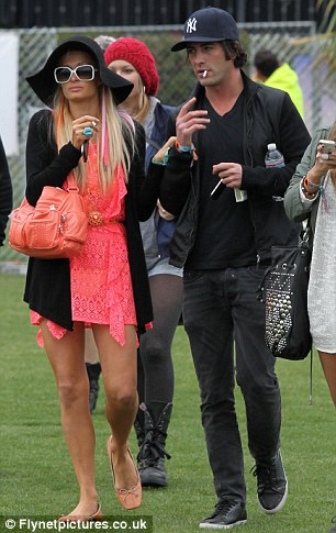 Old friends: Paris was seen hanging out at the festival with her old partying pal Brandon 'Greasy Bear' Davis