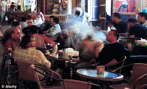 Hanging out: Qataris love to relax over a snack and a smoke