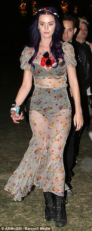 Beer jacket? Katy still cavorts in little more than underwear as night falls
