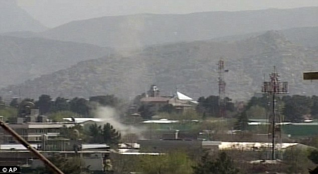 Smoke rises from Kabul today following attacks by Taliban militants on diplomatic residences