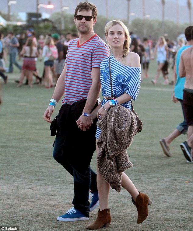 Sensational in stripes: Diane Kruger and boyfriend Joshua Jackson wore similar ensembles yesterday at Coachella