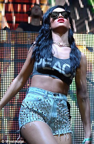 Minimal attire: Rihanna took to the stage in her skimpy ensemble to perform for fans