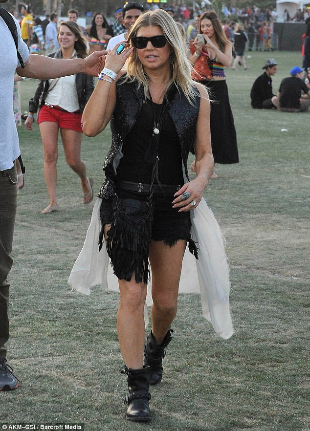 Back to black: The London Bridge singer was dressed a little more rock and roll for her second day at the festival