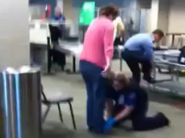 Shaken: The woman, who is not identified, can be heard sobbing as she's subjected to an invasive pat-down by a TSA agent