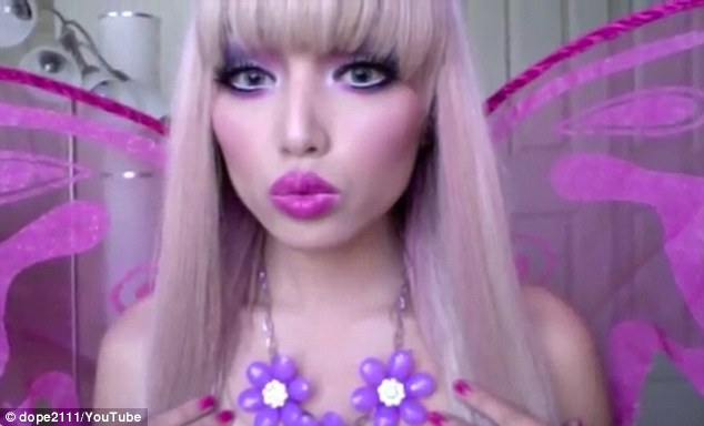 Pucker up: The transformation into Mariposa Barbie is complete with a wide-eyed kiss to the camerae