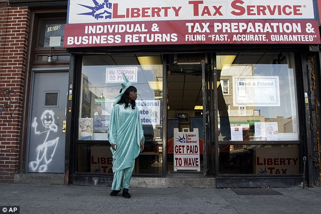 Mad money: A woman wearing a a Statue of Liberty costume encourages people to get their taxes done before today's deadline