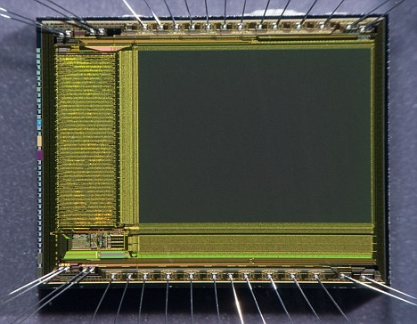 Close up of a CMOS chip - a new version of the commonly used chips would allow users to capture images 'through' walls and even inside the human body