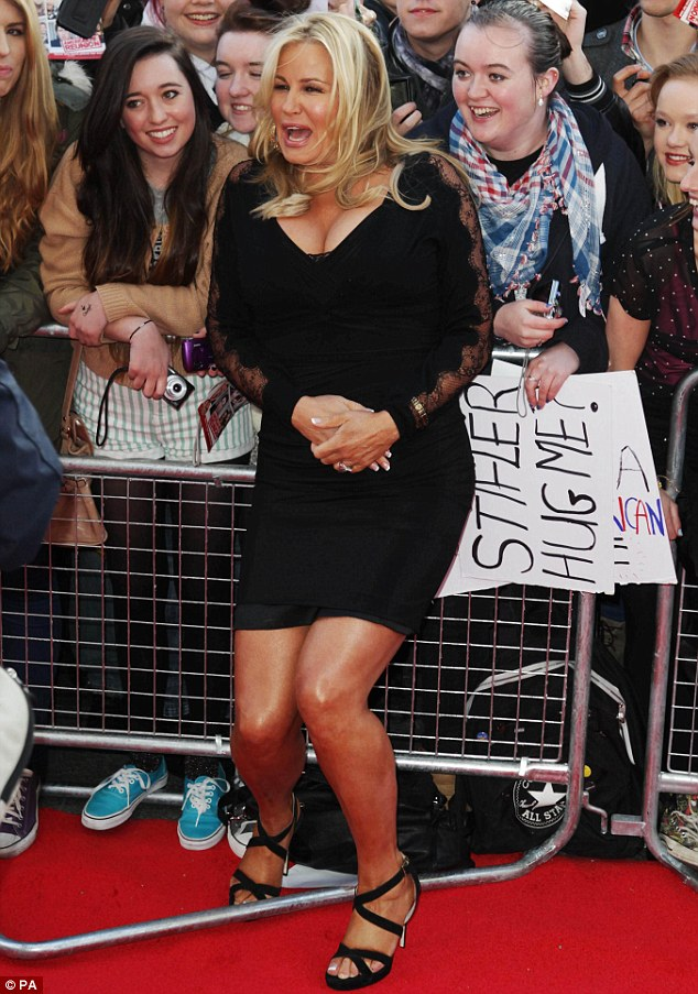 Centre of attention: Even Jedward's hair couldn't detract from Jennifer Coolidge's bust