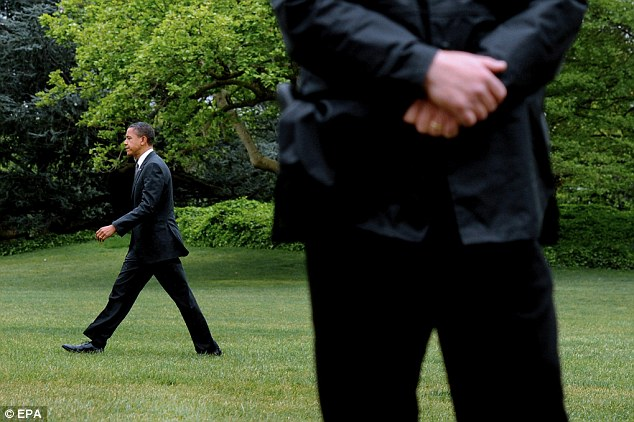 Embarrassment: U.S. President Barack Obama walks across the South Lawn of the White House, behind a Secret Service agent, in Washington DC, on Wednesday