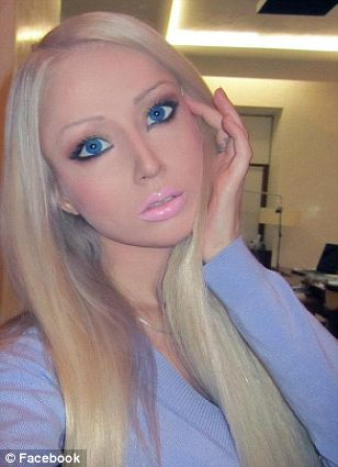 Twins: Her bright blue eyes and long blonde hair are almost identical to that of the traditional Barbie doll