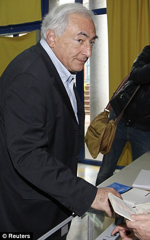 Famous voters: Disgraced former IMF chief Dominique Strauss-Kahn, left, votes in Sarcelles, while right, former French president Jacques Chirac's wife Bernadette is seen in a polling station in Sarran