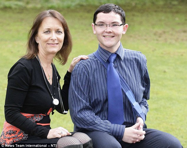 Savior: Steven with Dr Julia Piper who saved his life in Leicester. She made doctors take a second look at him before making the final decision to switch his life-support machine off