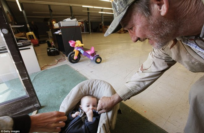 Baby Jacob Lucas rests inside a thrift store in Owsley County on April 19