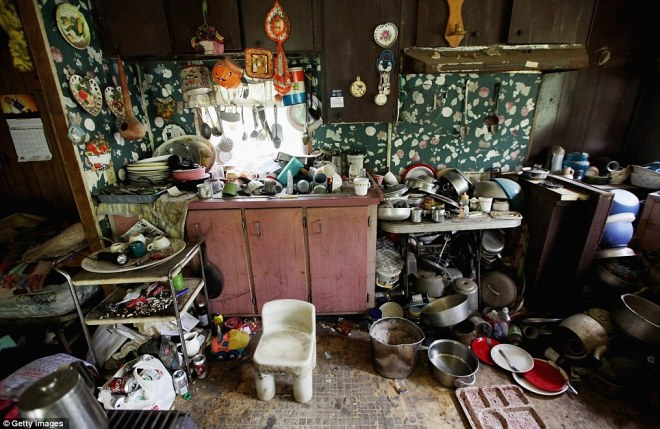 Slovenly: Former chimney sweeper Mose Noble keeps a kitchen littered with dirty pots, pans and dishes that spill onto the floor